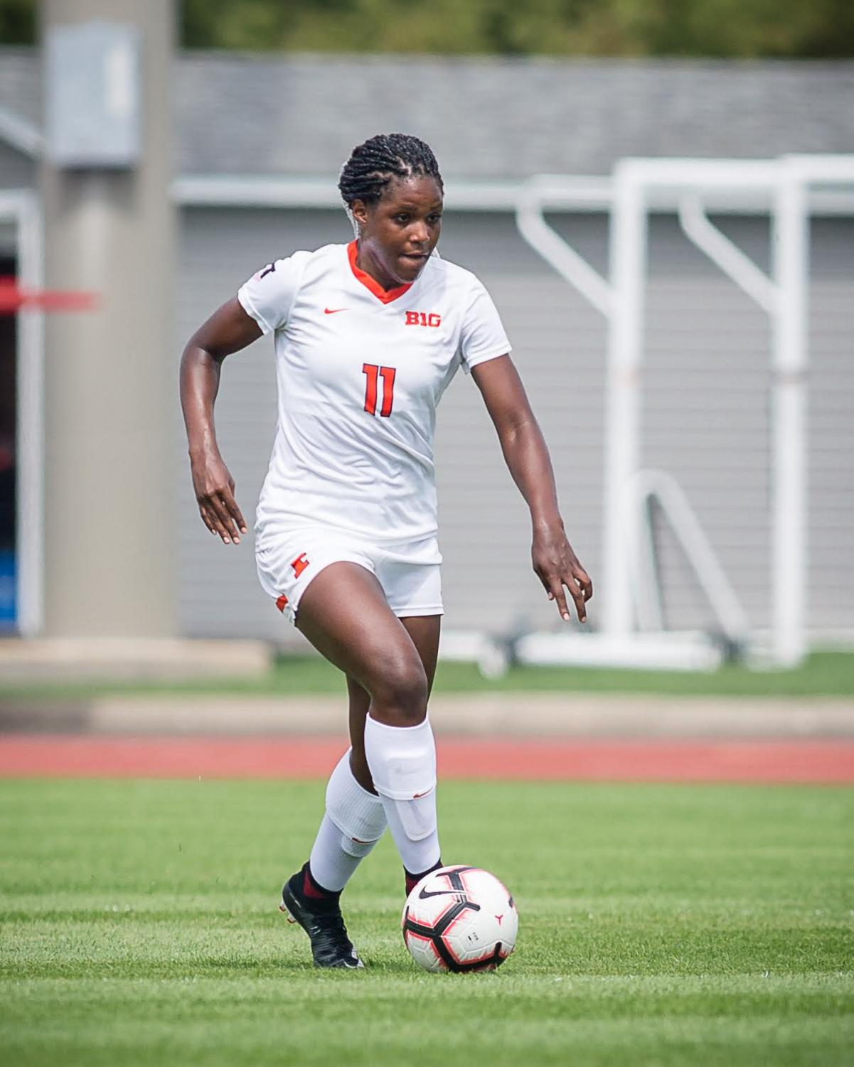 Illinois forward Patricia George (11) dribbles down the field during the game against Northern Illinois at the Illinois Soccer Stadium on Sunday, Aug. 26, 2018. The Illini won 8-0.