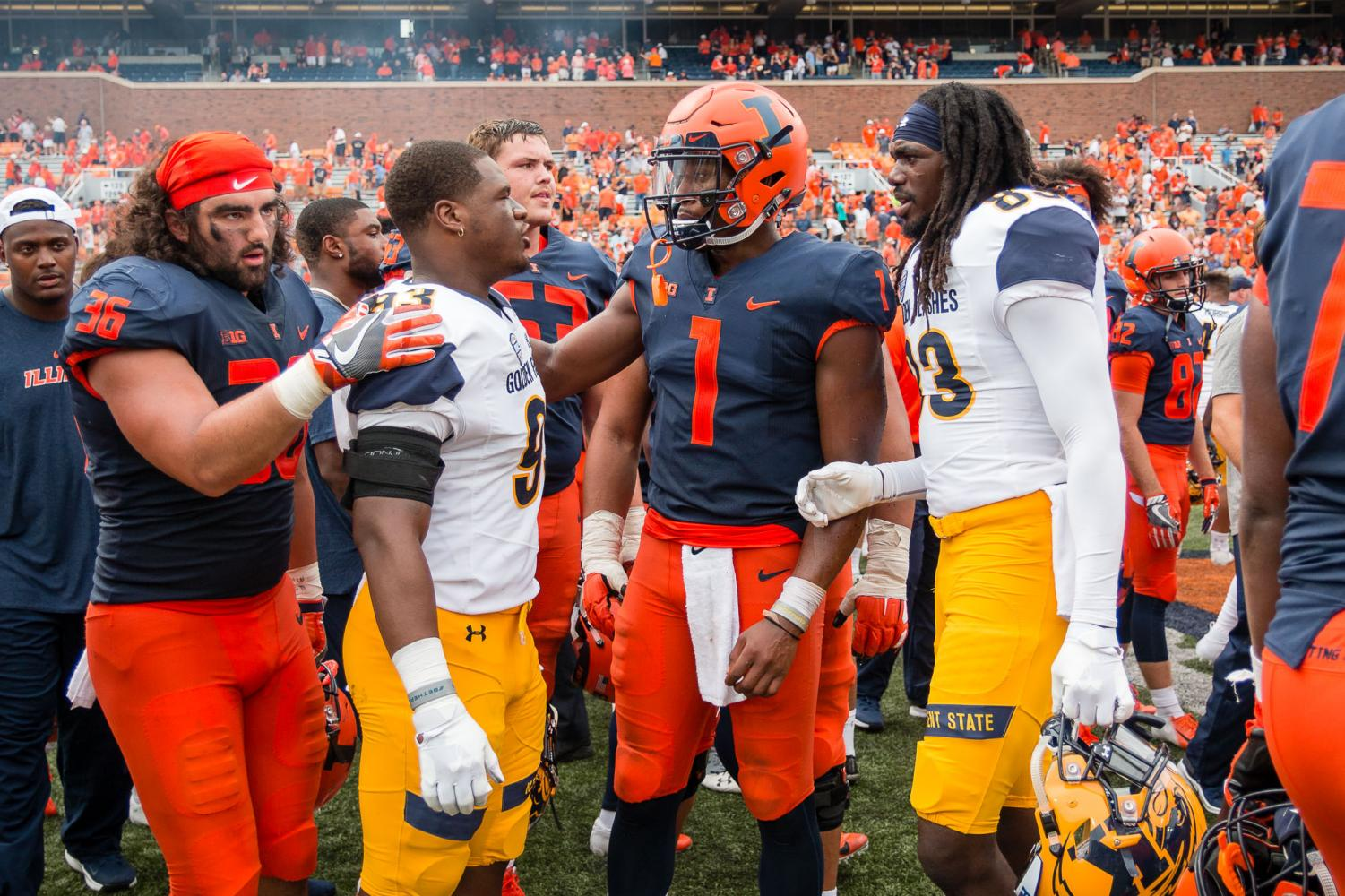 Illinois quarterback AJ Bush (1) talks to Kent State defensive lineman Matt Bell (93) and wide receiver Lon'kevious McFadden (83) after the game at Memorial Stadium on Saturday, Sept. 1, 2018.
