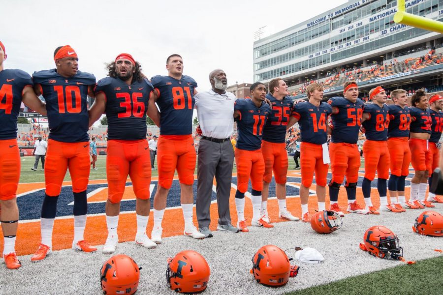 Illinois head coach Lovie Smith sings Hail to the Orange with his team after the game against Kent State at Memorial Stadium on Saturday, Sept. 1, 2018.