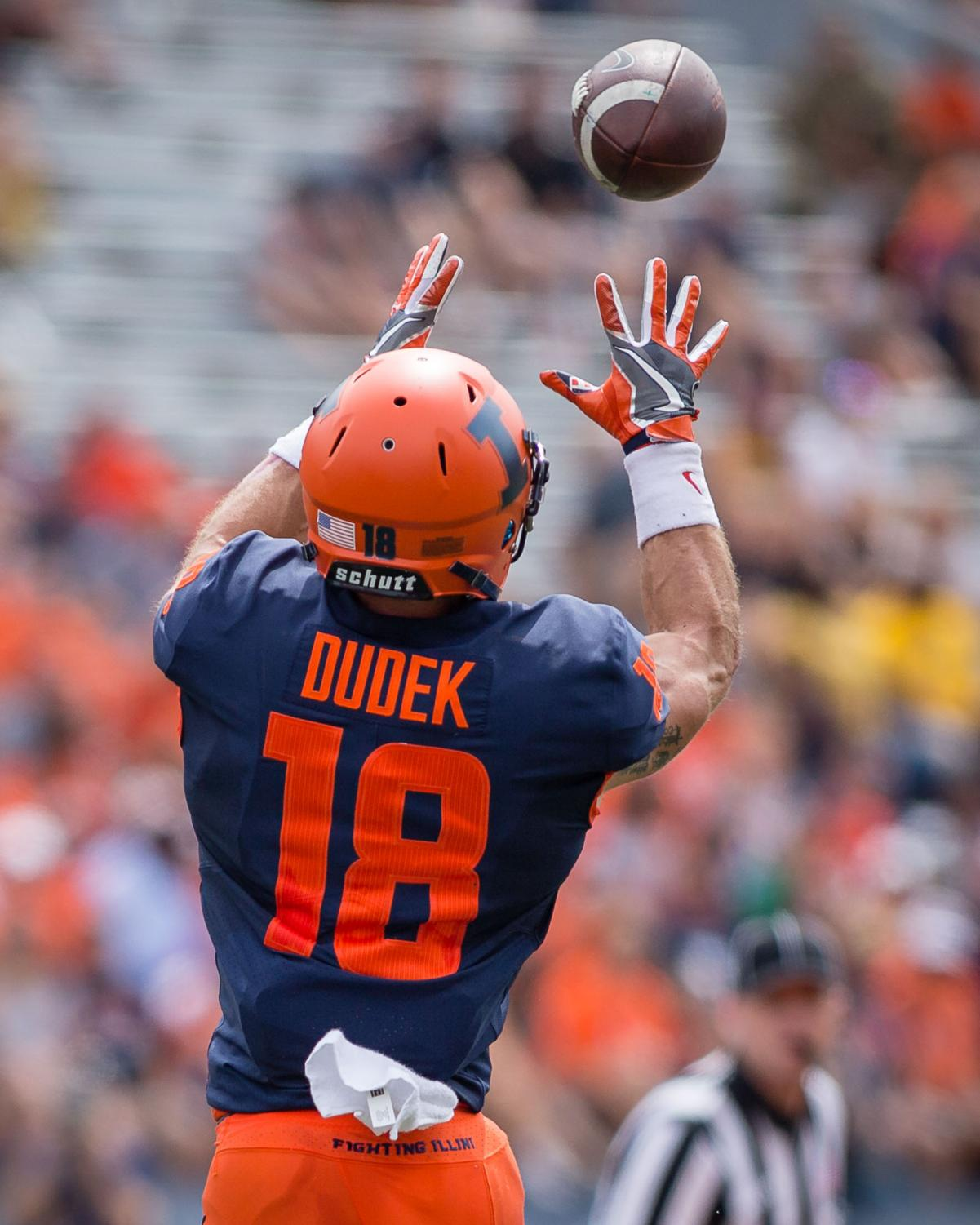 Illinois wide receiver Mike Dudek (18) leaps up to make a catch during the game against Kent State at Memorial Stadium on Saturday, Sept. 1, 2018.