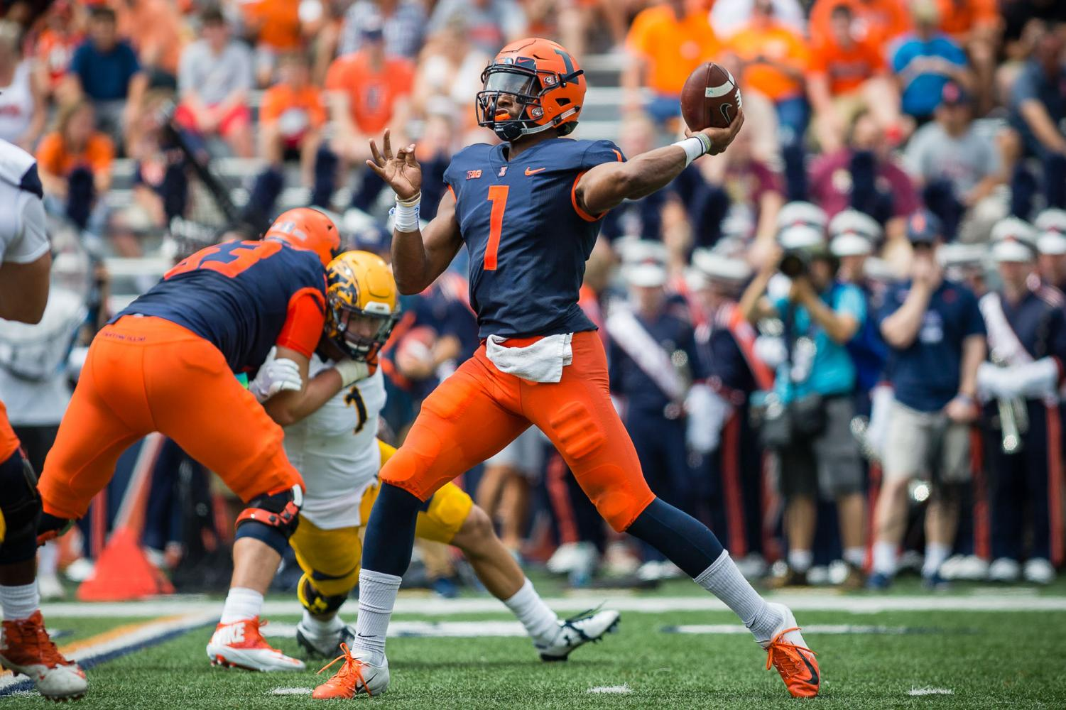 Illinois quarterback AJ Bush (1) throws a pass during the game against Kent State at Memorial Stadium on Saturday, Sept. 1, 2018.