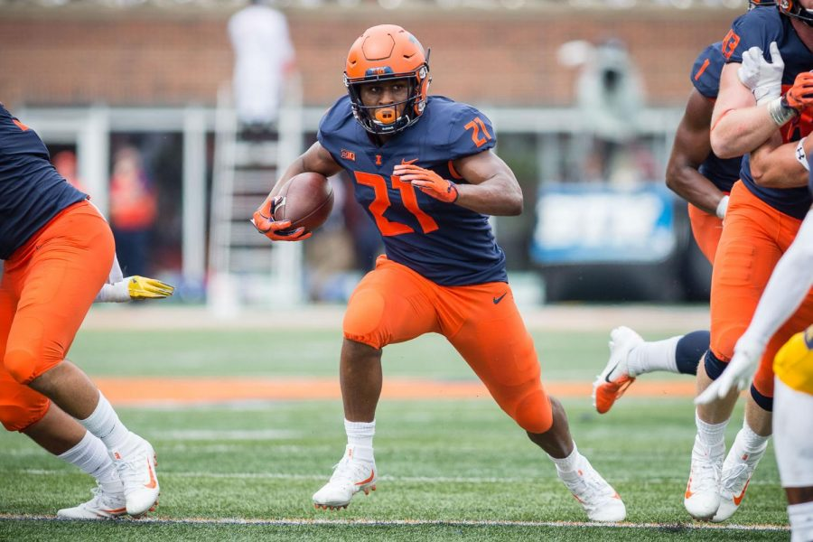 Illinois running back Ra'Von Bonner (21) rushes the ball during the game against Kent State at Memorial Stadium on Saturday, Sept. 1, 2018.
