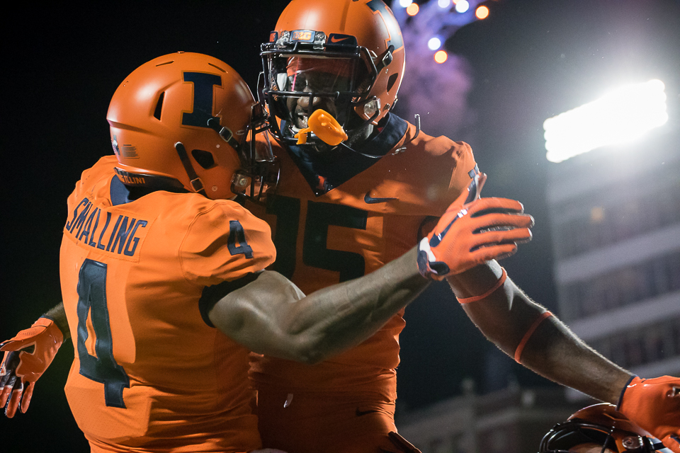 Illinois wide receiver Ricky Smalling (left) celebrates with wide receiver Trenard Davis (right) after scoring a touchdown during the game against Penn State at Memorial Stadium on Friday. The Illini lost 63-24.