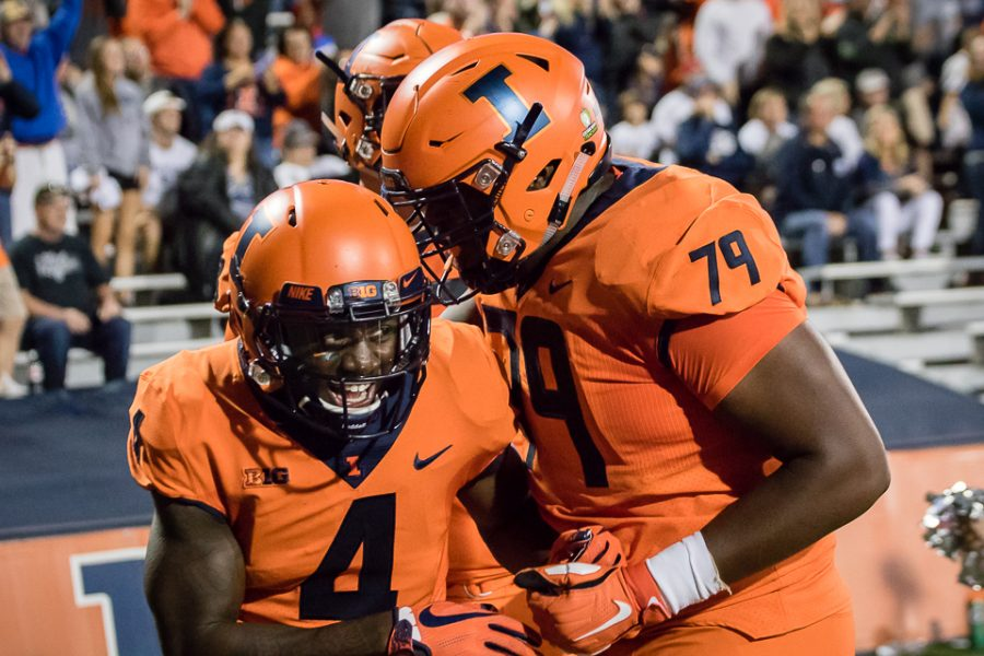 Illinois+wide+receiver+Ricky+Smalling+%284%29+celebrates+with+offensive+lineman+Vederian+Lowe+%2879%29+after+scoring+a+touchdown+during+the+game+against+Penn+State+at+Memorial+Stadium+on+Friday%2C+Sept.+21%2C+2018.+The+Illini+lost+63-24.