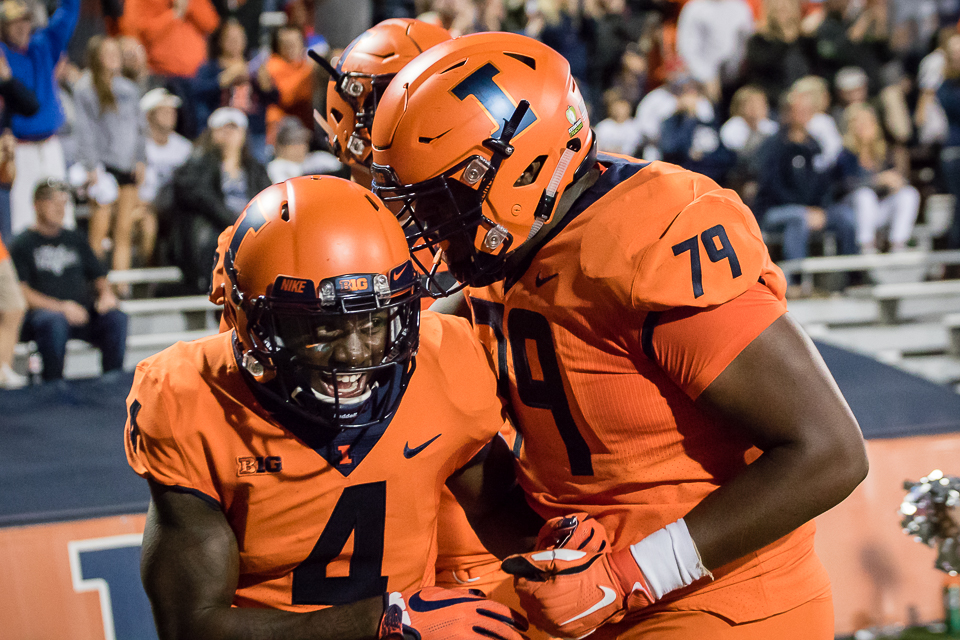 Illinois wide receiver Ricky Smalling (4) celebrates with offensive lineman Vederian Lowe (79) after scoring a touchdown during the game against Penn State at Memorial Stadium on Friday, Sept. 21, 2018. The Illini lost 63-24.
