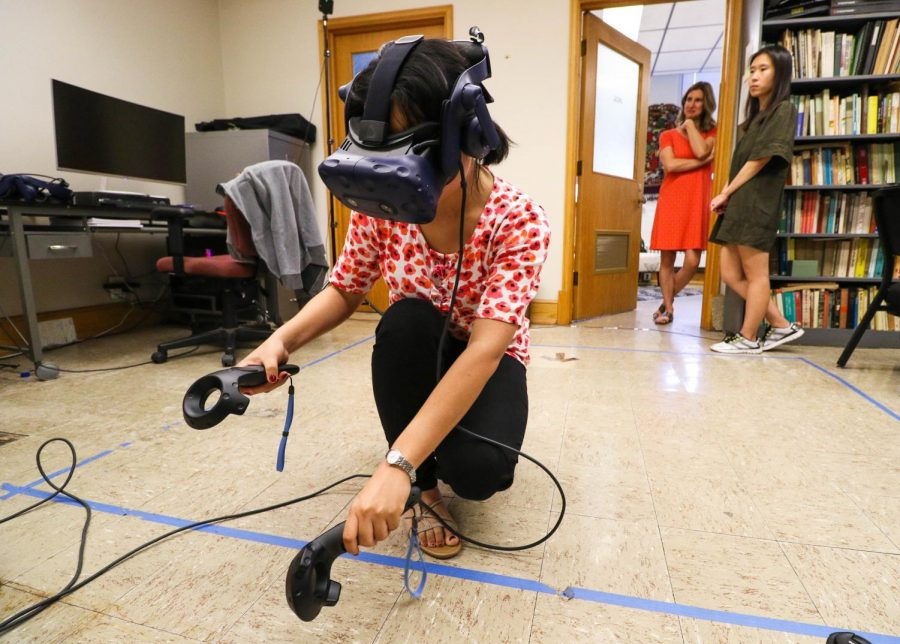 Graduate+student+Xuehui+Chao+works+the+virtual+reality+system+for+ANTH+399%2C+currently+in+development%2C+in+Davenport+Hall+on+Sep.+19.