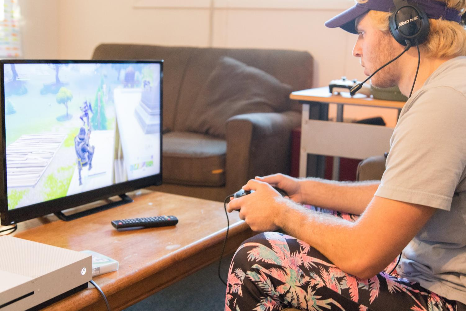 Mike Hoke plays a game of Fortnite in his apartment on Saturday.