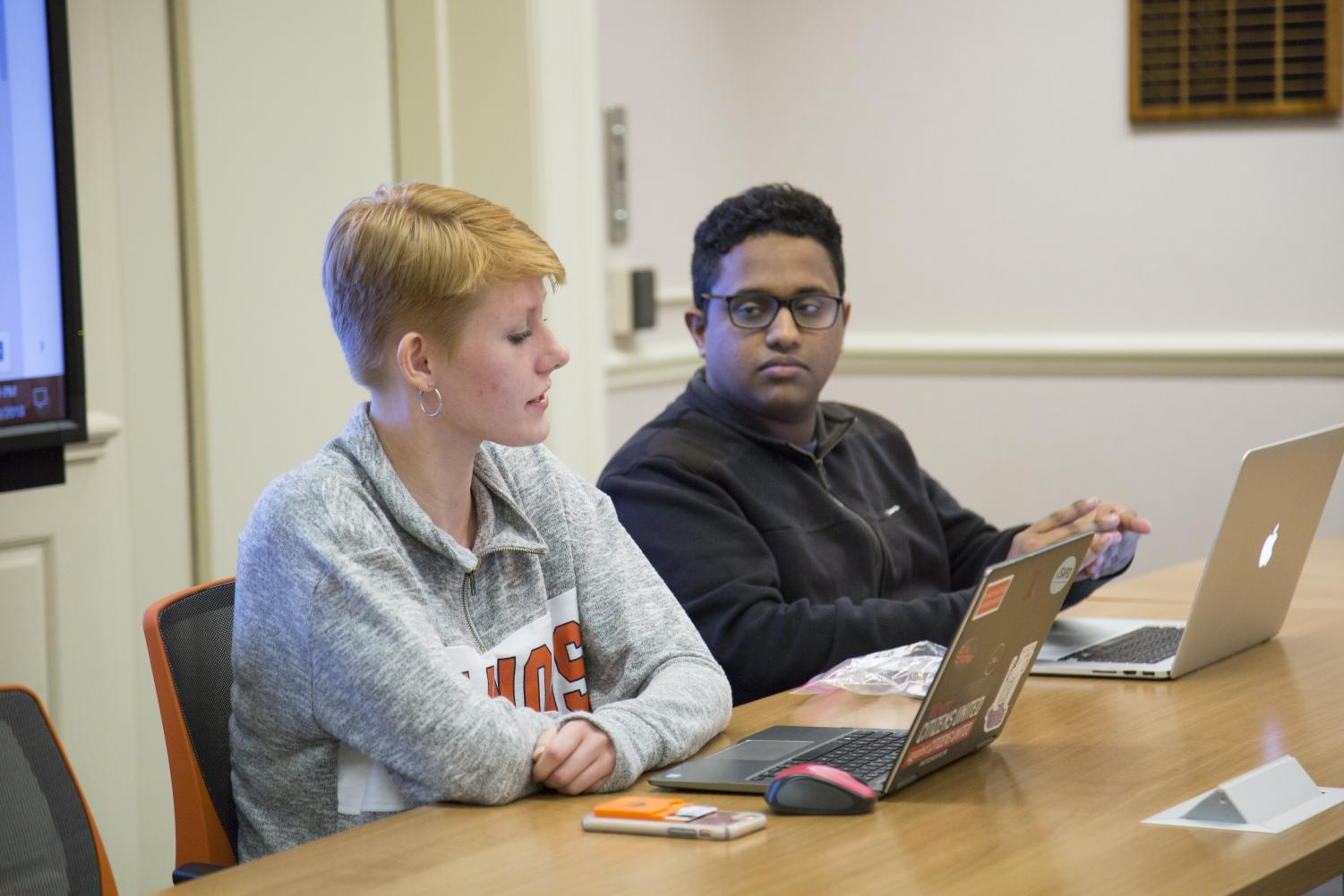 Students Kirsten Peterson and Rahul Raju discuss the accessibility of voting locations on Friday at an Illinois Student Senate Complex meeting. ISG has eight senate seats that have not been filled by various colleges on campus.