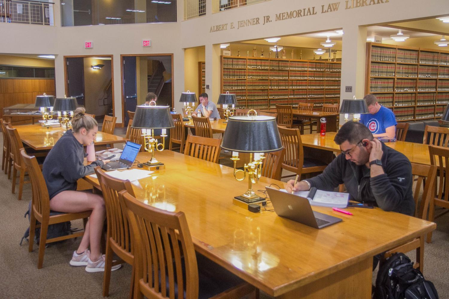 Law students study in the Albert E. Jenner Jr. Memorial Law Library on Tuesday. The law school entrance test will soon be conducted digitally on tablets.