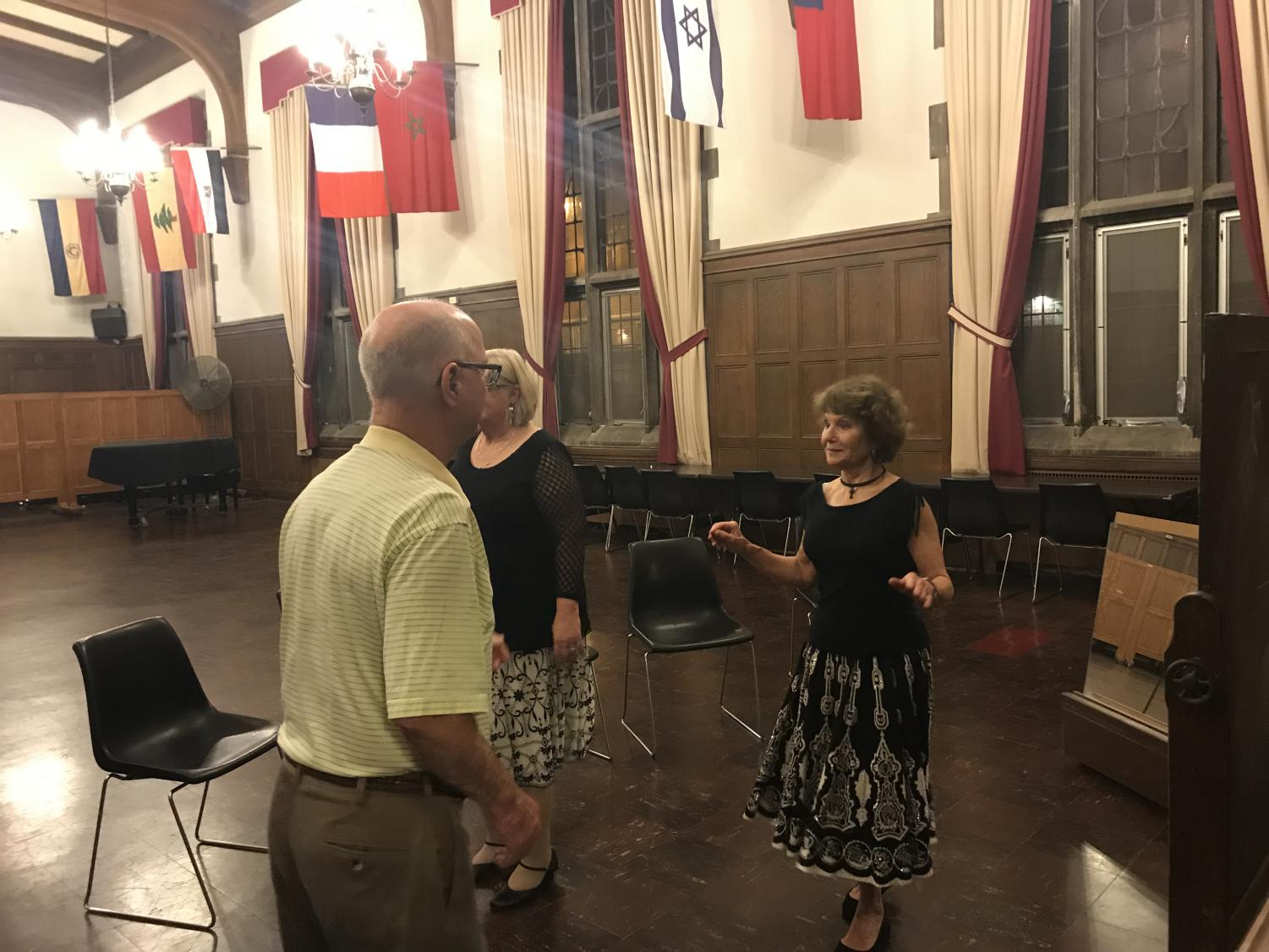 Aurora Villacorta teaches a samba class to Dena and Jim Vernette in Latzer Hall at the University YMCA on Monday.