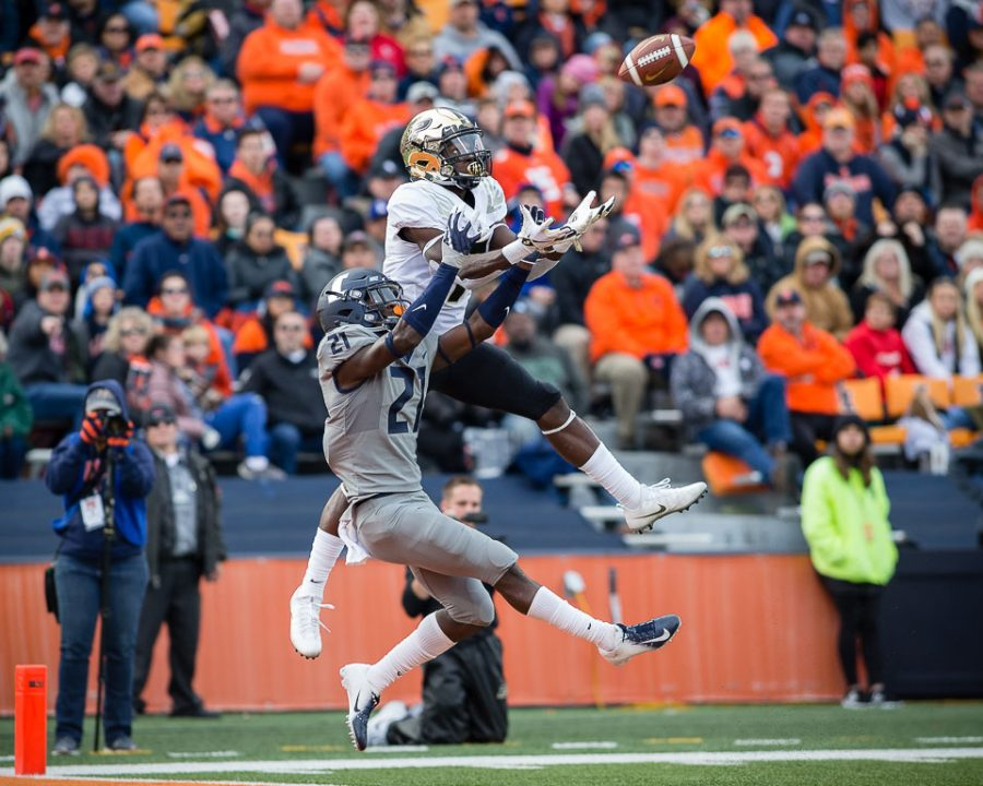 Purdue wide receiver Isaac Zico makes a touchdown catch over defensive back Jartavius Martin during the game against Purdue at Memorial Stadium on Saturday.