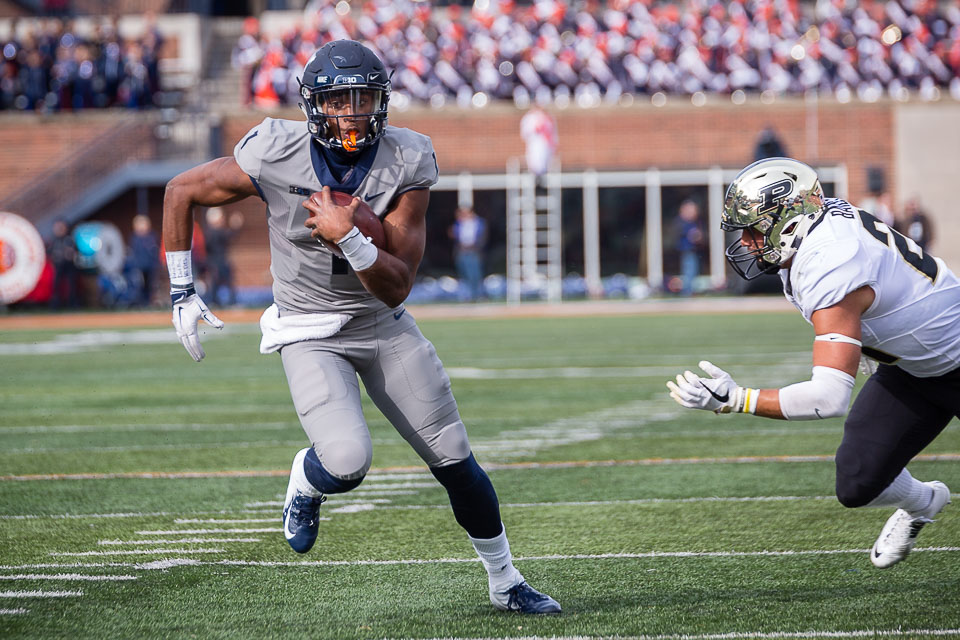 Illinois quarterback AJ Bush (1) rushes the ball for a touchdown during the game against Purdue at Memorial Stadium on Saturday, Oct. 13, 2018.