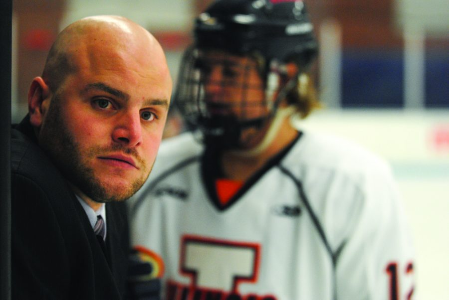 Head coach Nick Fabbrini looks to the referee for an explanation of a penalty call during the game against No. 2 Ohio at the Ice Arena Saturday night, November 3, 2012.