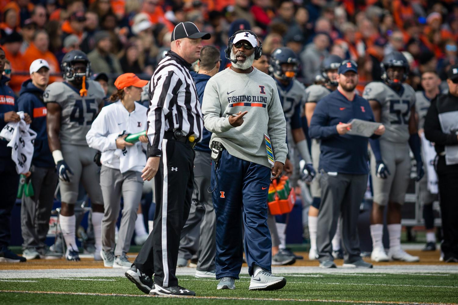 Illinois head coach Lovie Smith talks to the referee during the game against Purdue at Memorial Stadium on Saturday. The Illini lost 46-7.