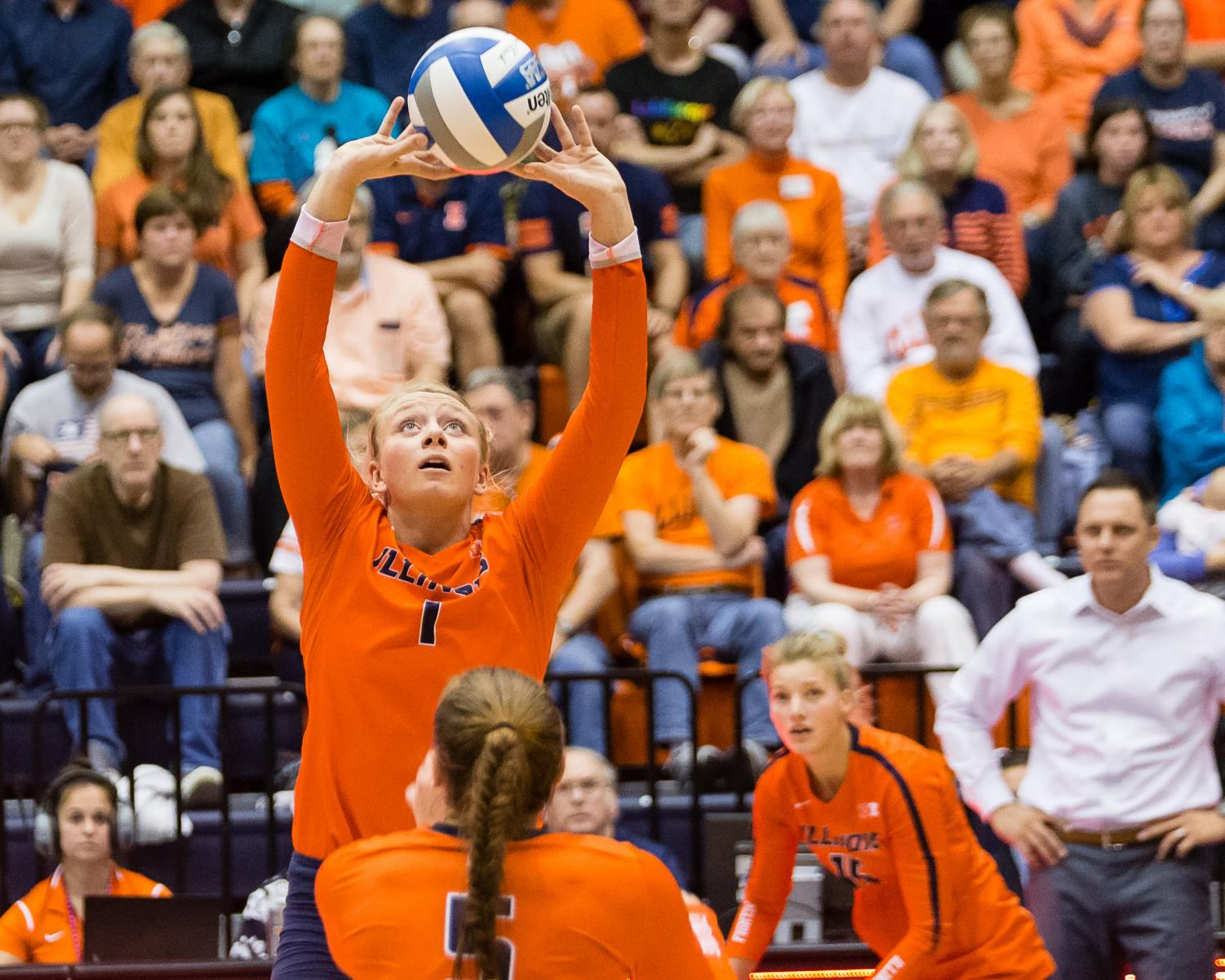 Illinois setter Jordyn Poulter (1) sets the ball during the match against Iowa at Huff Hall on Sept. 28. The Illini won 3-0.