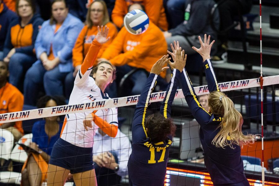 Illinois+outside+hitter+Jacqueline+Quade+spikes+the+ball+during+the+match+against+Michigan+at+Huff+Hall+on+Oct.+19.+The+Illini+won+3-2.