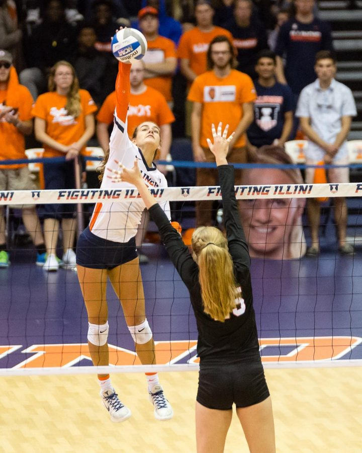 Illinois+outside+hitter+Jacqueline+Quade+hits+the+ball+from+the+back+row+during+the+match+against+Nebraska+at+Huff+Hall+on+Sept.+29.+The+Illini+lost+3-1.