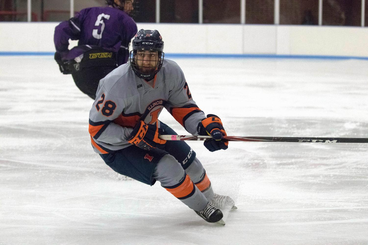 Evan Sabo (28) skates up to the boards to take possession of the puck from McKendree at the Ice Arena on Friday, Oct. 13th. Illinois beat McKendree 4-2.