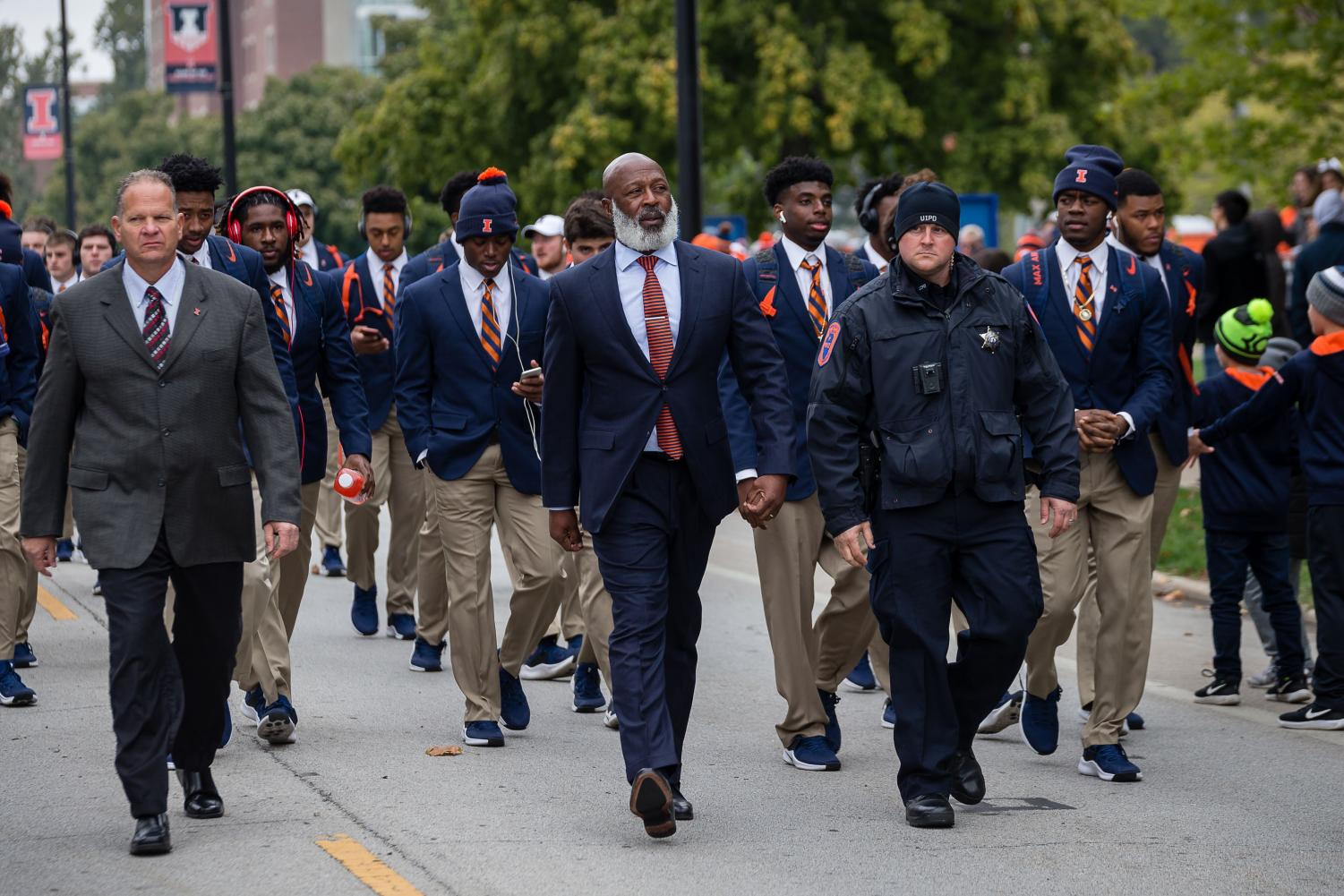 Illinois head coach Lovie Smith walks with his team down First Street before the game against Purdue at Memorial Stadium on Oct. 13. Georgia tight end Luke Ford has announced he is transferring to Illinois due to familial reasons.