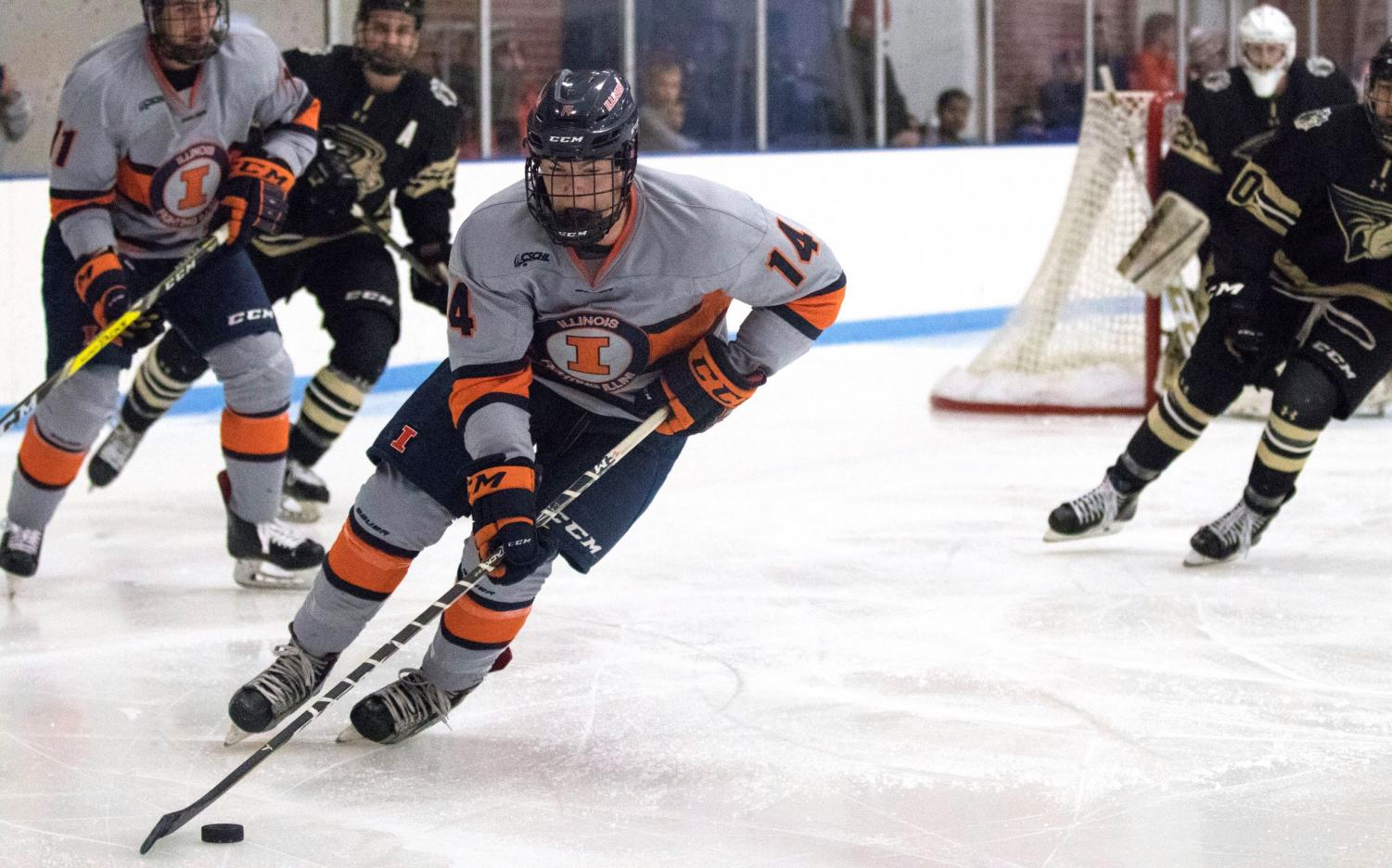 Neil Novosel skates past Lindenwood's players to gain possession of the puck at the Ice Arena on Dec. 1.  Illini won in overtime 2-1.