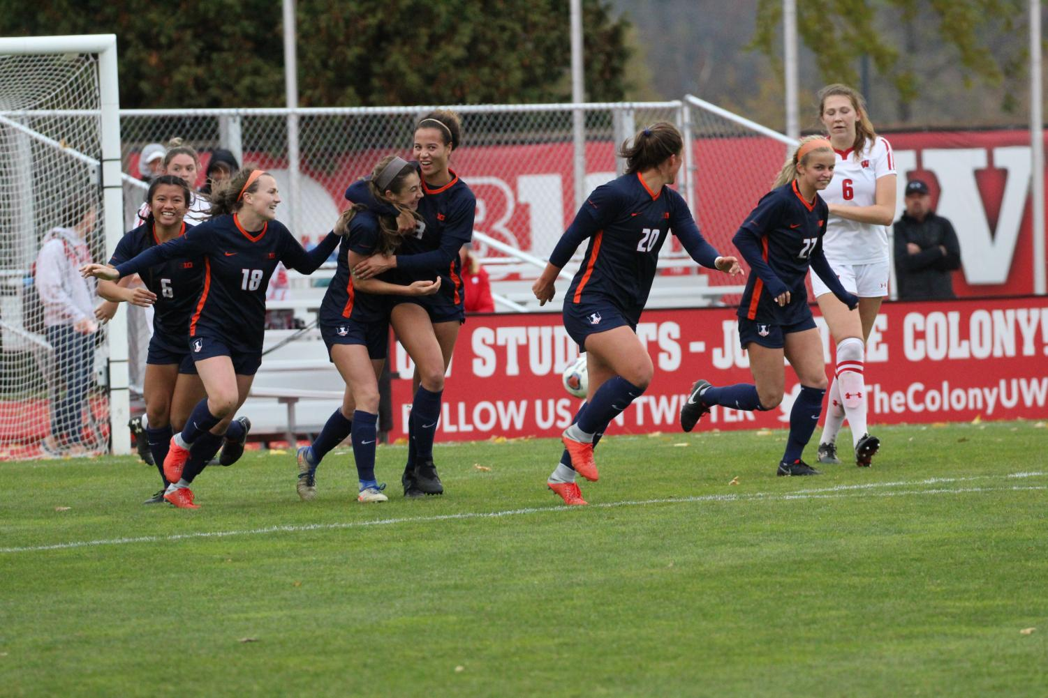 The Illinois soccer team celebrates during its Big Ten quarterfinals win over Wisconsin. The team won its first tournament game since 2012 by going 3-0 in penalty kicks.