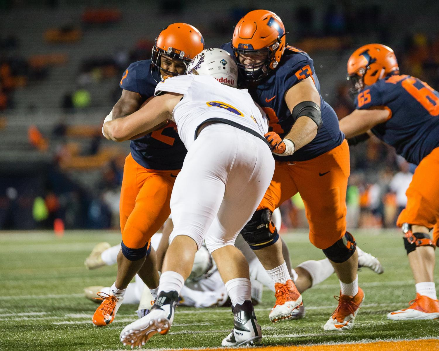 Illinois offensive lineman Nick Allegretti (53) blocks for running back Reggie Corbin (2) on his way to the end zone during the game against Western Illinois at Memorial Stadium on Sept. 8.