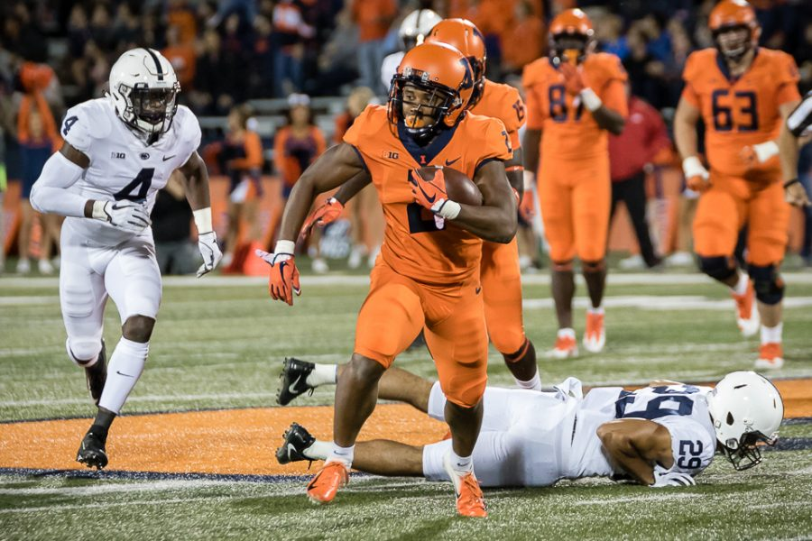 Illinois running back Reggie Corbin (2) carries the ball down the field during the game against Penn State at Memorial Stadium on Friday, Sept. 21, 2018. The Illini lost 63-24.