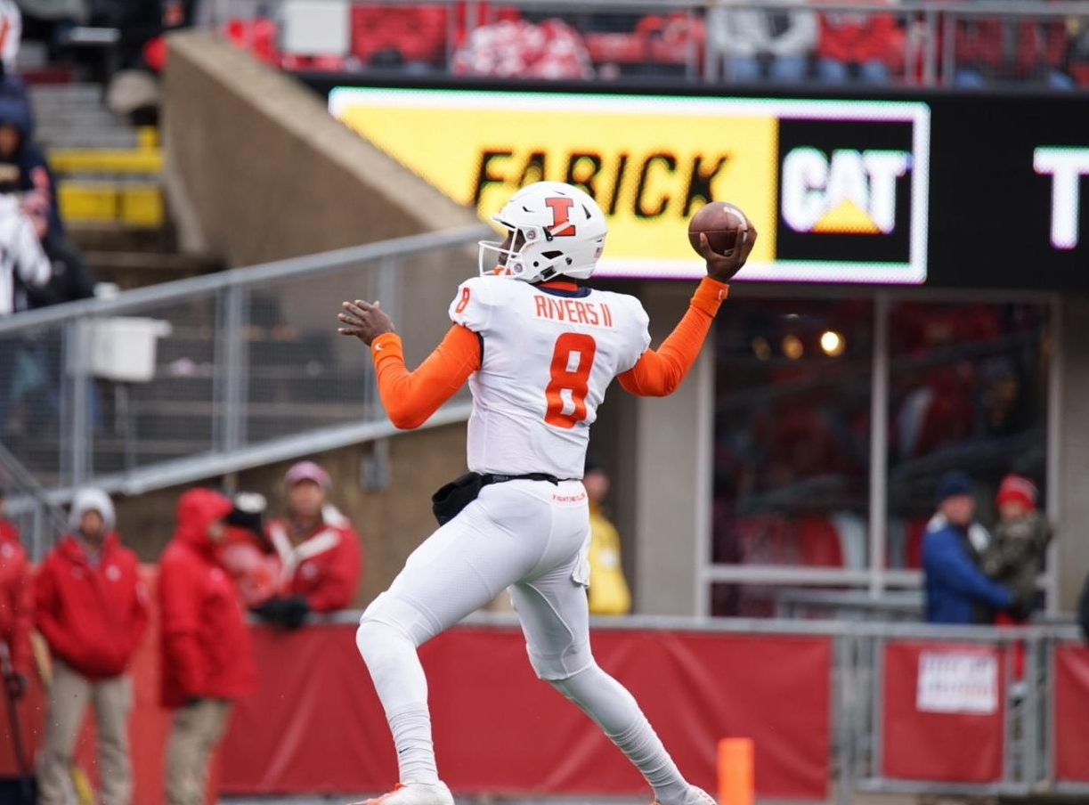 Freshman M.J. Rivers drops back to pass in Illinois game against No. 23 Wisconsin Saturday. The Illini lost 49-20.