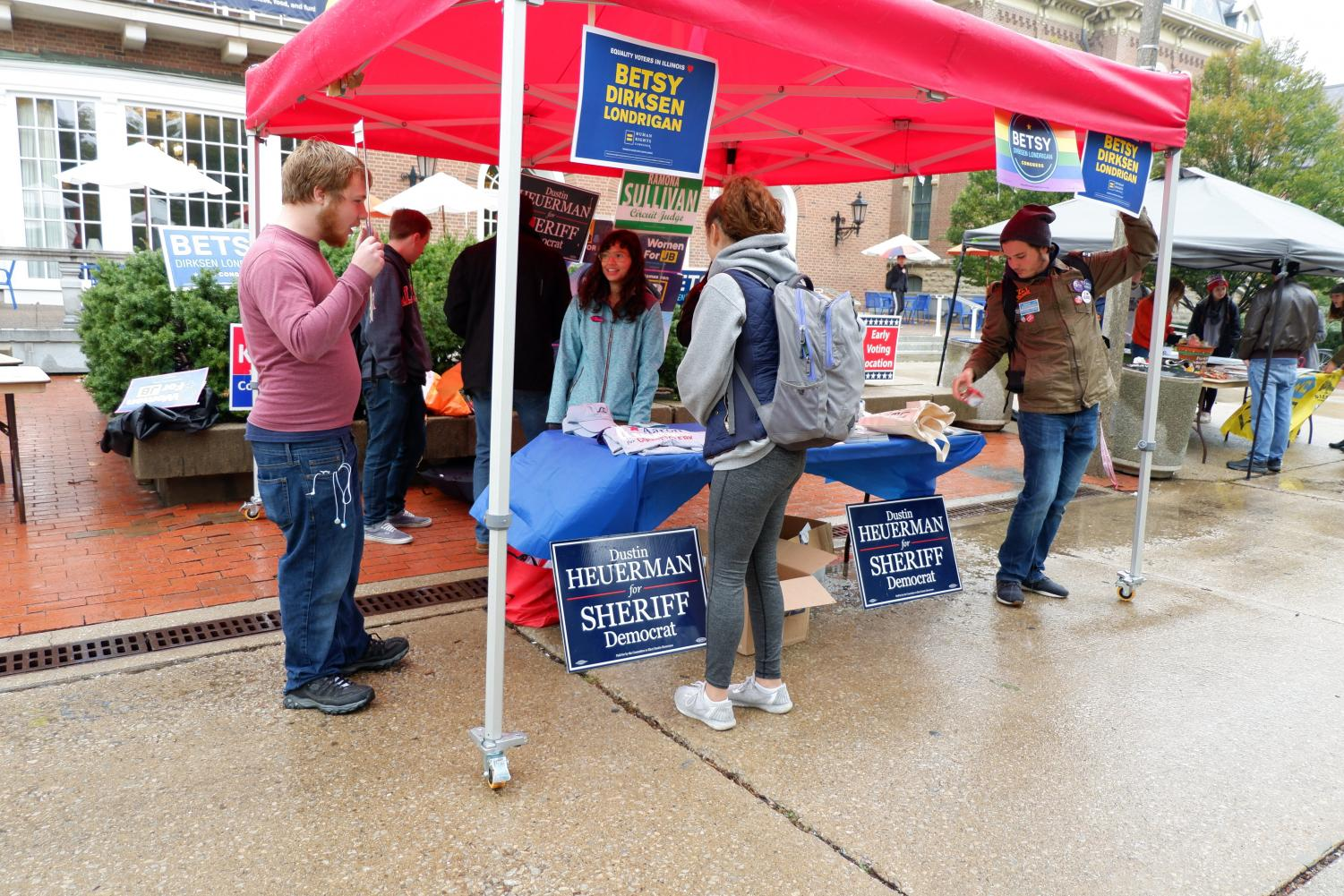 Students visit a tent set up on the Main Quad in front of the Illini Union during Pollapalooza on Friday. The event was created to encourage students to vote in the upcoming election and included information tables, free food and live music.