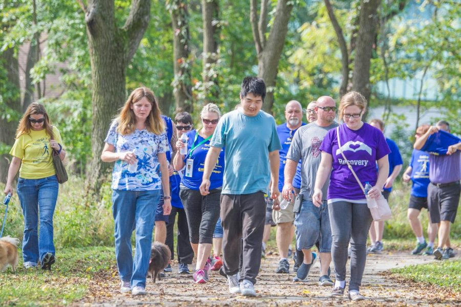 Participants+in+the+NAMI+walk+take+their+first+steps+along+the+two-mile+course+at+Meadowbrook+Park+on+Sunday%2C+Oct.+7.+Local+chapters+of+NAMI+worked+together+to++organize+the+event%2C+which+they+hope+to+continue+to+hold+annually.