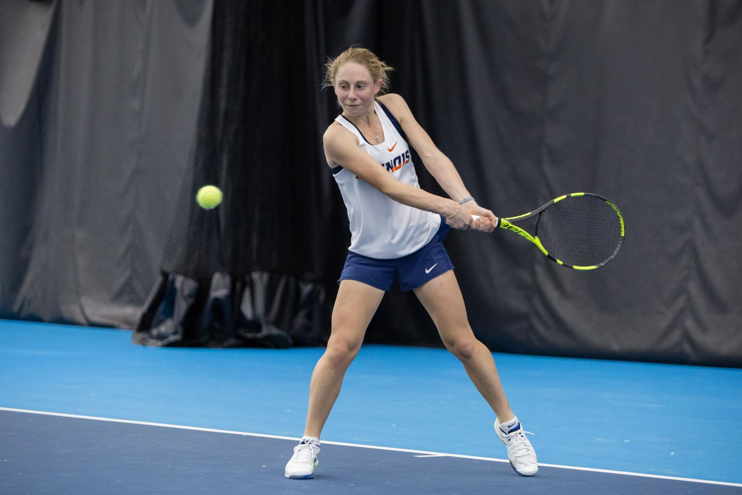 Illinois' Mia Rabinowitz gets ready to return the ball during her singles match against Texas at Atkins Tennis Center on Feb. 2, 2018. Rabinowitz won her singles match 6-2, 7-6[2], and the Illini won 4-2.
