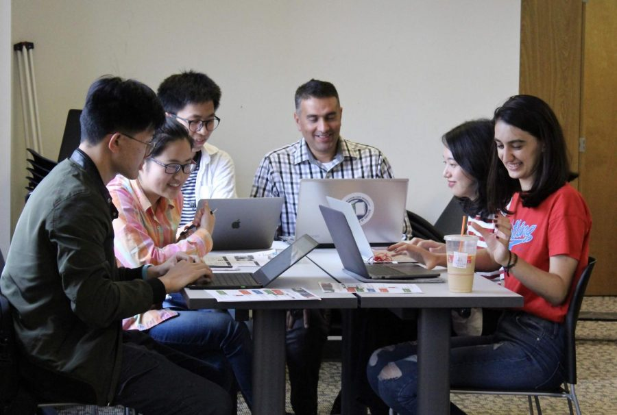 International+students+talk+in+groups+about+job+hunting+and+networking+on+Oct.+1+