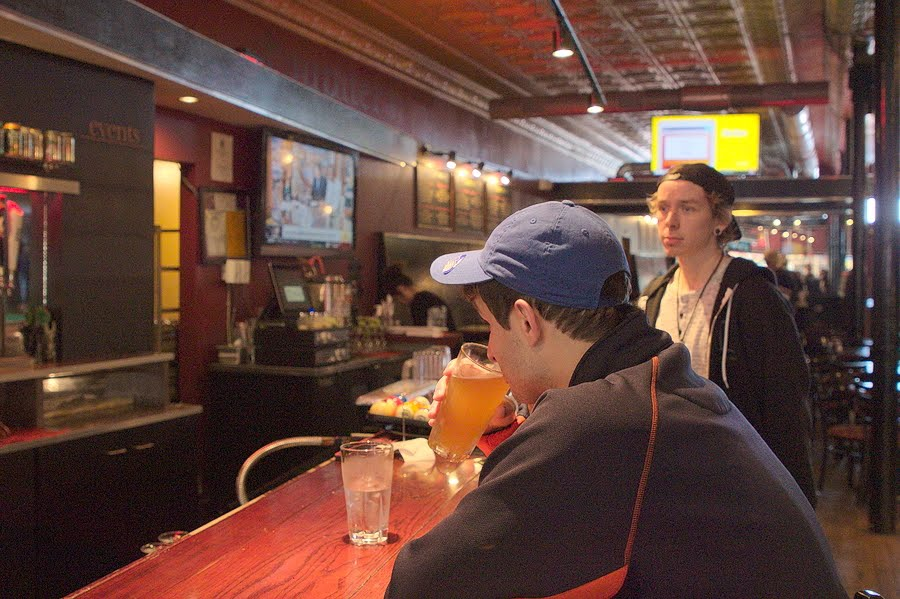 Local resident Jacob Carter and Allan Hay sit at the bar at Jupiter's Pizzeria and Billiards, located in downtown Champaign, on Oct. 11. The University was ranked No. 7 in top ten college towns, citing Jupiter's as one of the city's iconic pizza places.