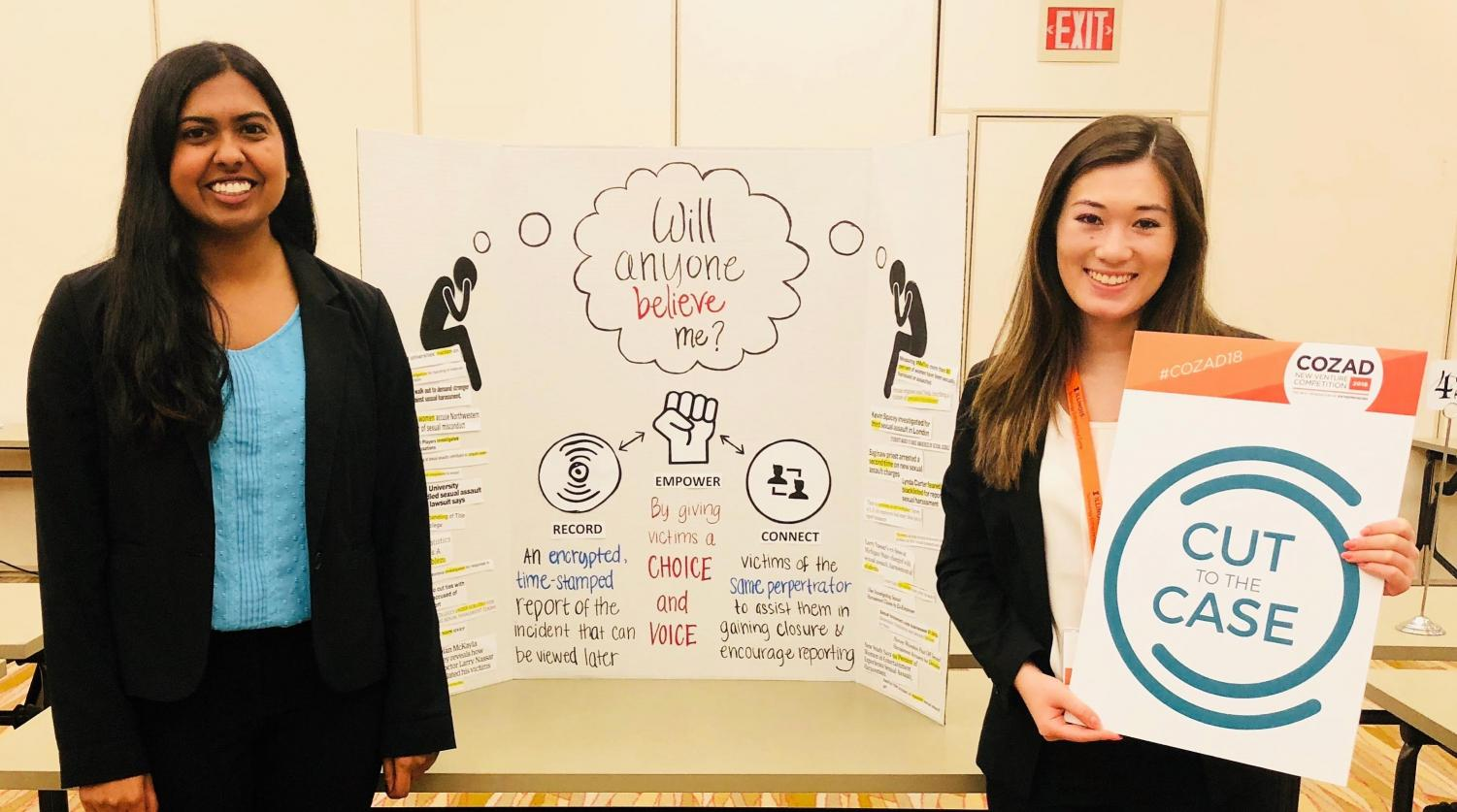 Premika Pandian, left, and Kendall Furbee, right, stand in front of their presentation at the Cozad New Venture Competition at the University in April. Their start-up, Cut to the Case, received a prize of $5,000 for Social Innovation at the competition with their creation of an online platform that would crowd-source crime reports to increase campus safety.