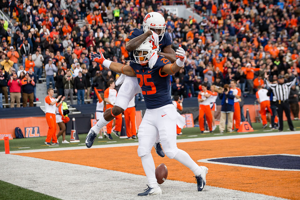 Illinois running back Dre Brown (25) celebrates with wide receiver Ricky Smalling (4) after scoring a touchdown during the game against Minnesota at Memorial Stadium on Saturday, Nov. 3.