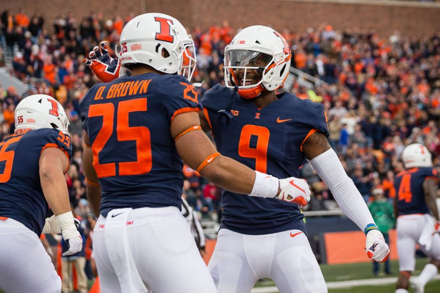 Illinois+running+back+Dre+Brown+%2825%29+celebrates+with+wide+receiver+Sam+Mays+%289%29+after+scoring+a+touchdown+during+the+game+against+Minnesota+at+Memorial+Stadium+on+Saturday%2C+Nov.+3%2C+2018.