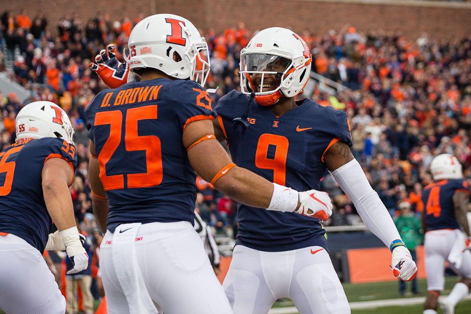 Illinois running back Dre Brown (25) celebrates with wide receiver Sam Mays (9) after scoring a touchdown during the game against Minnesota at Memorial Stadium on Saturday, Nov. 3, 2018.