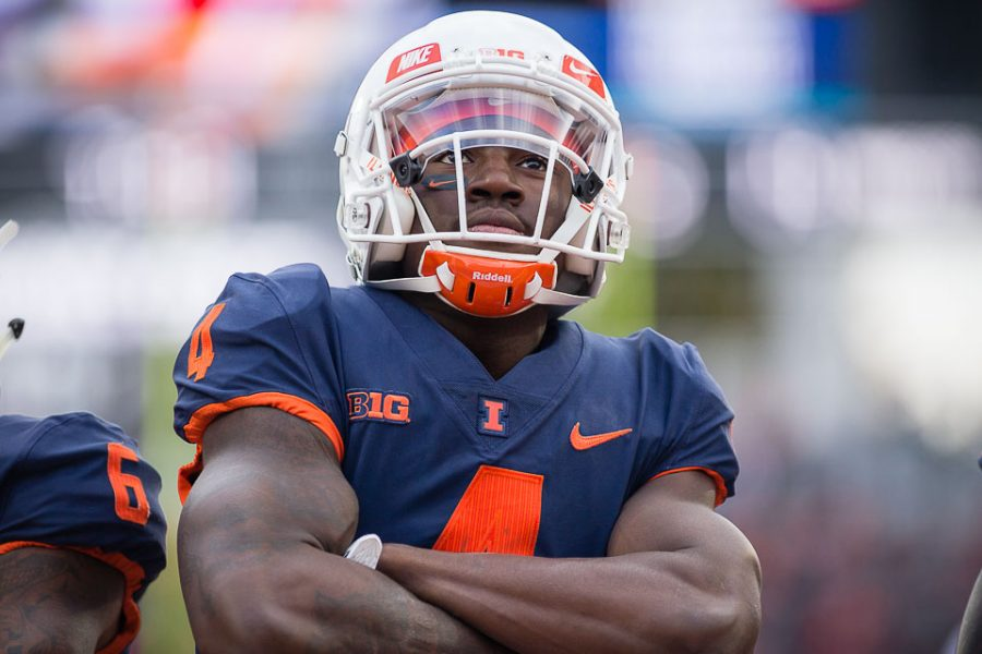 Illinois wide receiver Ricky Smalling (4) poses in the endzone after scoring a touchdown during the game against Minnesota at Memorial Stadium on Saturday, Nov. 3.