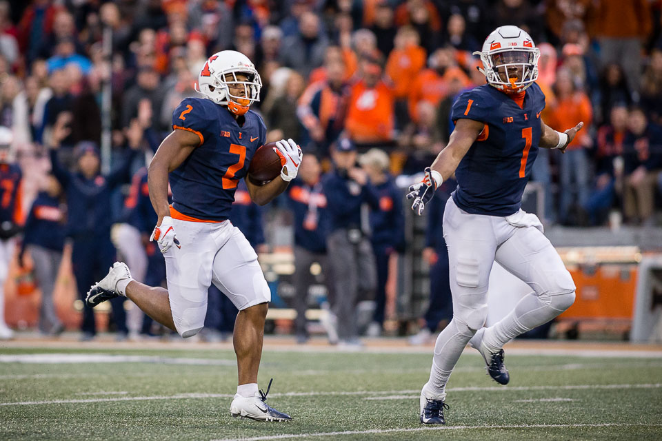Illinois running back Reggie Corbin (2) carries the ball down the field for a touchdown during the game against Minnesota at Memorial Stadium on Saturday, Nov. 3.