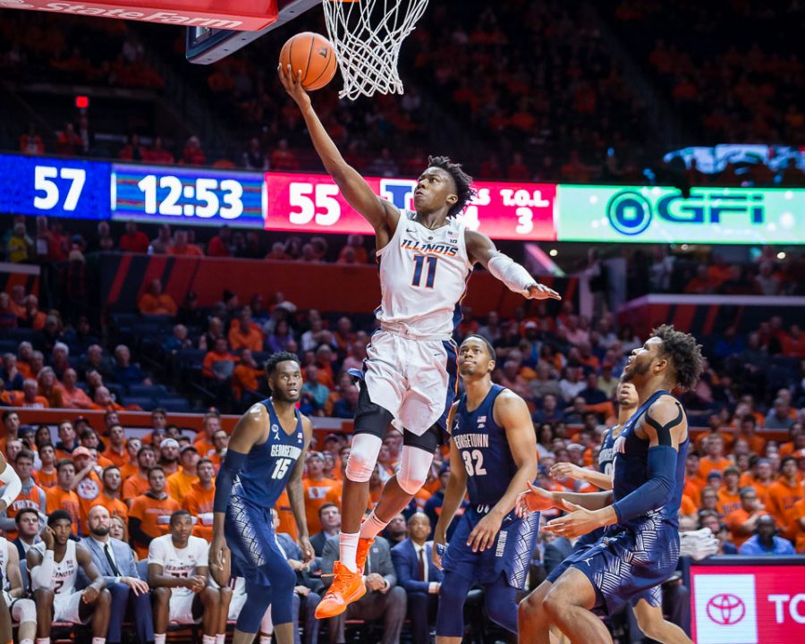 True+freshman+point+guard+Ayo+Dosunmu+jumps+for+a+layup+during+the+game+against+Georgetown+at+the+State+Farm+Center+Tuesday.+Dosunmu+finished+with+25+points+as+the+Illini+lost+88-80.