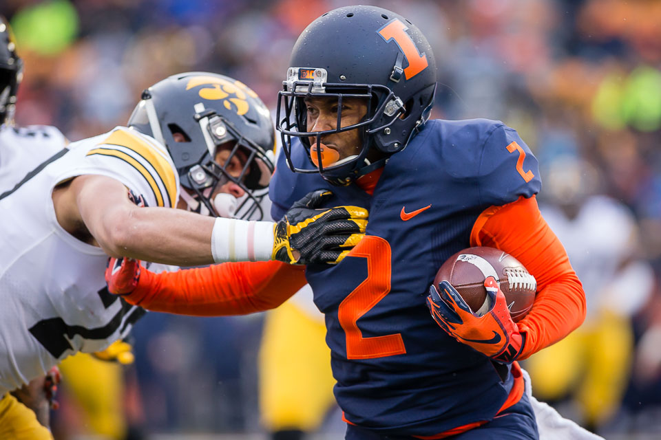 Illinois running back Reggie Corbin (2) stiff arms a defender during the game against Iowa at Memorial Stadium on Saturday, Nov. 17, 2018.