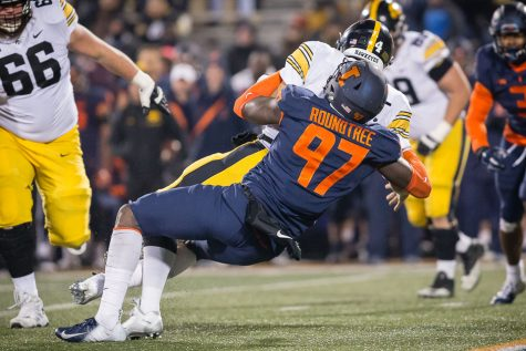 Beckman to return in 2015 for Illinois football