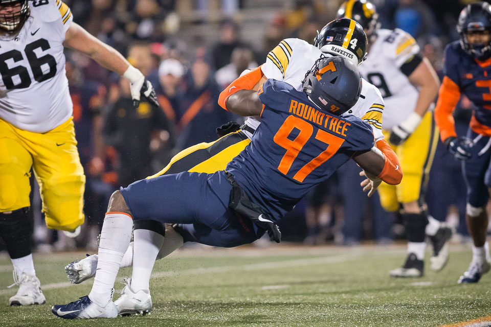 Illinois defensive lineman Bobby Roundtree (97) sacks Iowa quarterback Nate Stanley (4) during the game against Iowa at Memorial Stadium on Nov. 17, 2018. Roundtree suffered a major spinal injury on Monday.