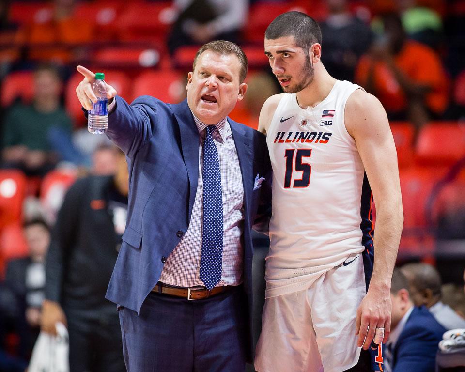 Illinois head coach Brad Underood talks to forward Giorgi Bezhanishvili (15) during the game against Evansville at State Farm Center on Thursday, Nov. 8, 2018.