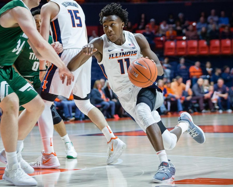 Illinois+guard+Ayo+Dosunmu+drives+to+the+basket+during+the+exhibition+game+against+Illinois+Wesleyan+at+the+State+Farm+Center+on%0AFriday%2C+Nov.+2%2C+2018.+The+Illini+won+83-67.