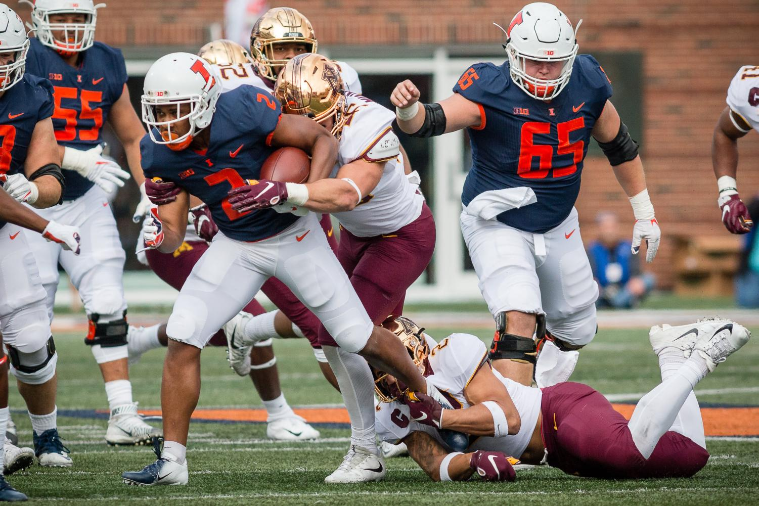 Illinois running back Reggie Corbin tries to break a tackle during the game against Minnesota at Memorial Stadium on Nov. 3. The Illini won 55-31.