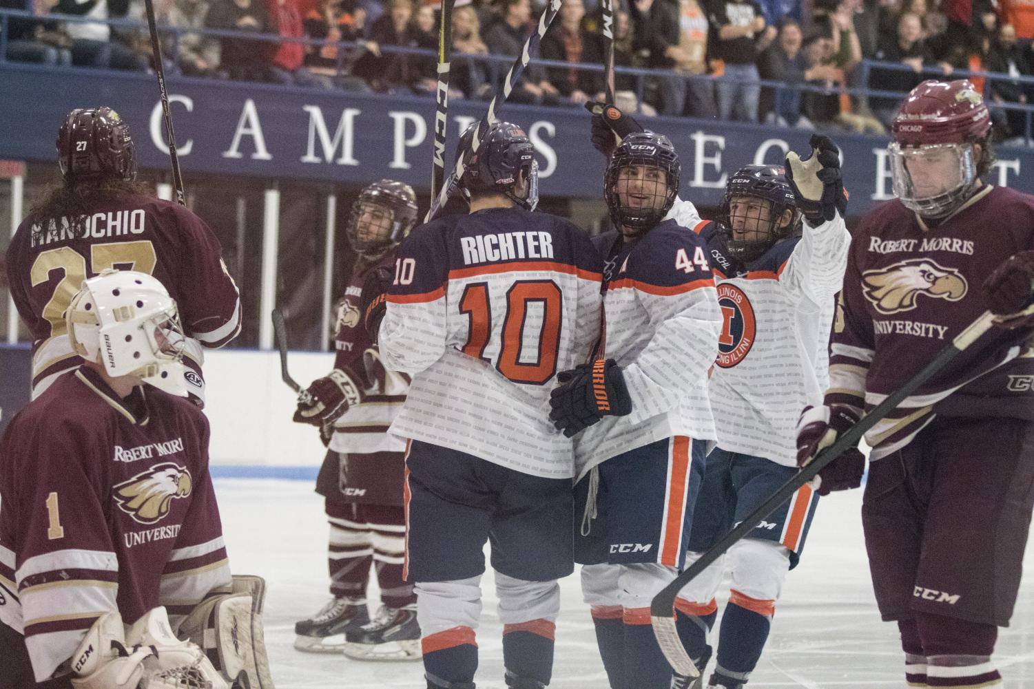 Drew Richter, Luke Forfar and Stephen Quinn celebrate a goal against Robert Morris at the Ice Arena on Nov. 2. The Illini shut out the team 6-0.