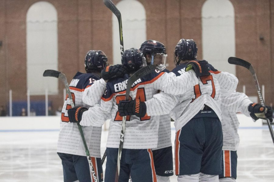 The+line+on+the+ice+celebrates+a+goal+against+Robert+Morris+at+the+Ice+Arena+on+Nov.+2.+The+Illini+shut+out+Robert+Morris+6-0.