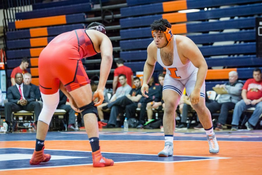 Illinois%E2%80%99+Deuce+Rachal+wrestles+with+Maryland%E2%80%99s+Youssif+Hemida+in+the+285-pound+weight+class+during+the+meet+at+Huff+Hall+on+Jan.+28.+The+Illini+won+25-18.+Rachal+will+compete+this+year+alongside+his+two+brothers+who+joined+the+program.