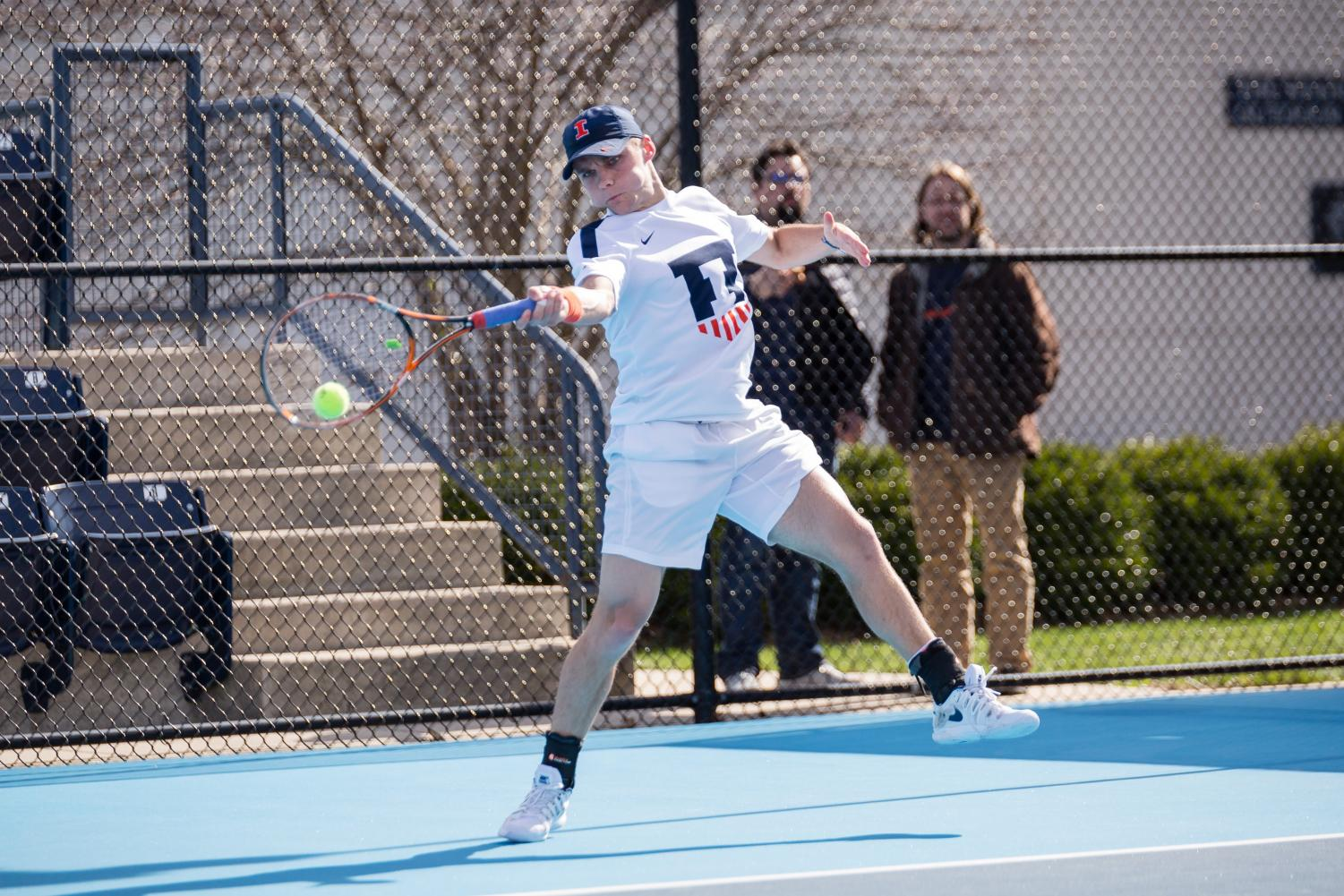 Junior Zeke Clark serves the ball during a match. The men's tennis team boasts several powerful duos in fast-paced doubles matches, leaving plenty to look out for this season.